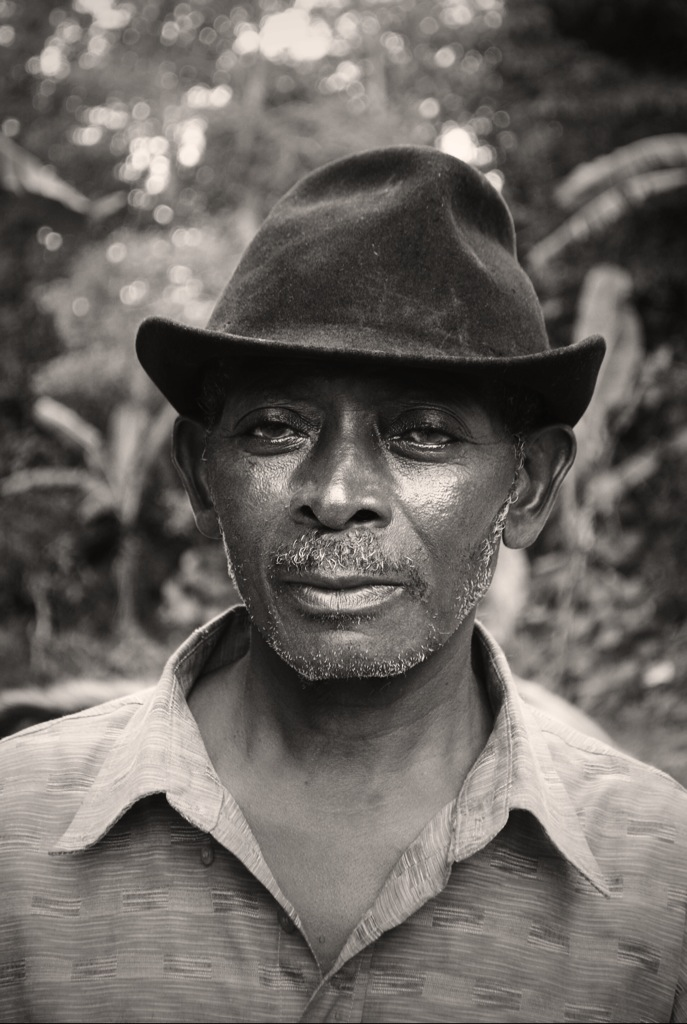 This is a man from Cap-Haïtien, Haïti. I was fascinated by his eyes so I told him that he was a beautiful man. He seemed so surprised! Like no one ever told him that he looked good before.