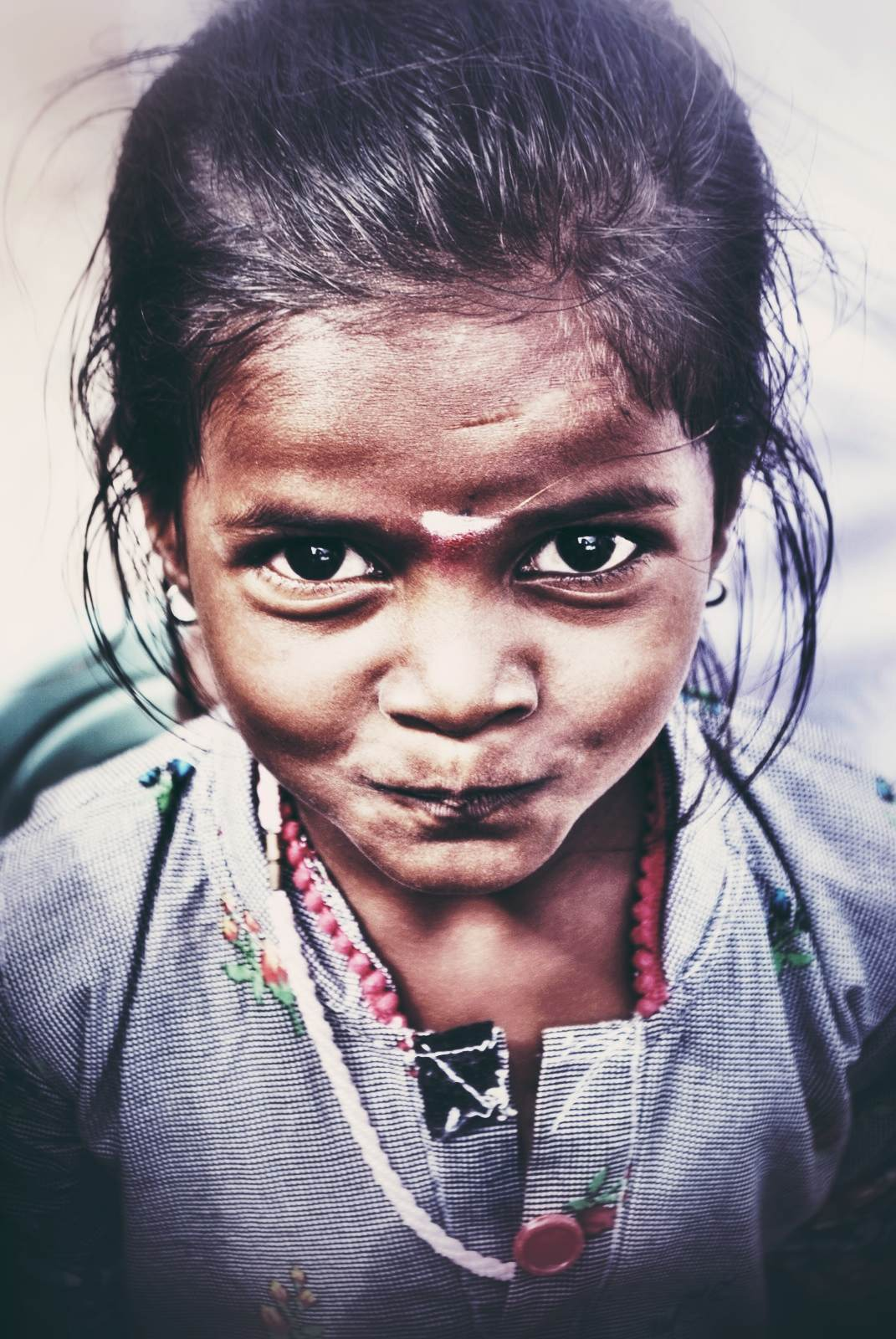 This is a little girl I met in the streets of Hampi, Karnataka, India. She seemed so excited to be captured by my big camera.